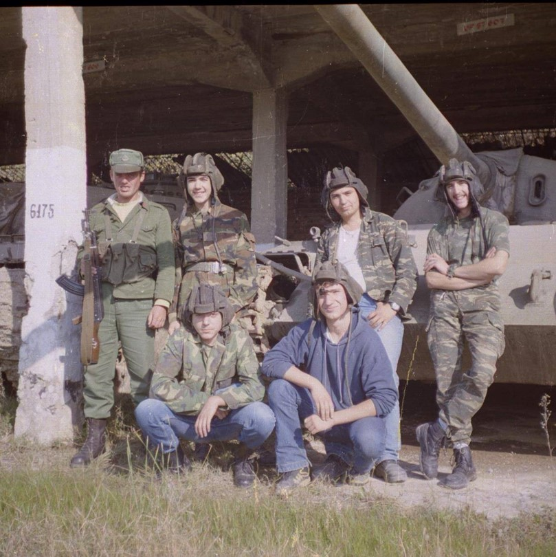 Mario [on the right, with crossed arms] with his friends; sharing his passion for the military aircraft, 1999.